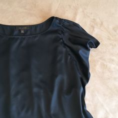 Gorgeous black flutter -sleeve blouse. The Limited. Gorgeous black flutter -sleeve blouse. Excellent like-new condition. The Limited Tops Blouses