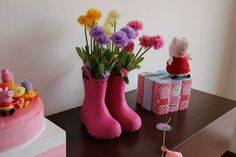 Pink rainboots flower arrangement at a Peppa Pig birthday party! See more party planning ideas at CatchMyParty.com!