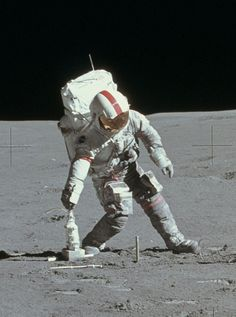 «45 YEARS AGO TODAY: Apollo 15 astronaut Dave Scott picks up a drill off the surface of the Moon (August 1, 1971) (NASA)».
