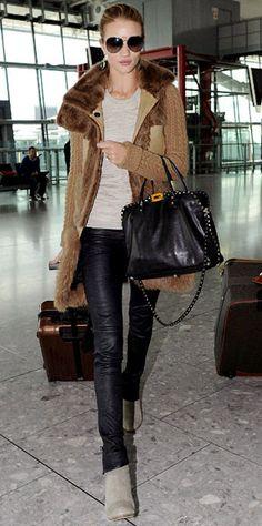 Rosie Huntington-Whiteley struts through the airport.
