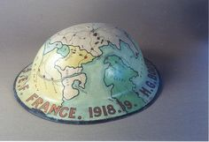 This helmet is a nice example of trench art, showing a map of the Western Front of WOrld War I. The brim of the helmet is marked 'H.G. Booth, 110th TMB AEF France 1918-'19'. Henry G. Booth was a cook for the 110th Trench Mortar Battery. AEF stands for 'American Expeditionary Force'.