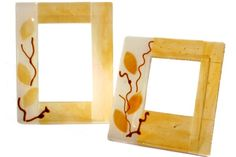"Murano glass fusing photo frame. Elegant composition that combines rigorous geometric lines of the frame with the sinuosity of the natural pattern of leaves and climbing stems. Characterized by a delicate combination of colours ochre-white silk. This object is made entirely by hand and is therefore a unique piece, it can thus submit variations in color shades and ""murrine"", depending on availability and composition. This guarantees the originality and quality of craft product Made in Italy."