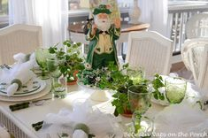 Ireland theme table: shamrocks, calla lilies, or white flowers, clover,  Table cover: shamrock fabric tablecloth, emerald green tablecloth, or colors of the Irish flag (emerald green, orange, and white) Nibbles: Gold-foil-wrapped chocolate coins and Lucky Charms cereal