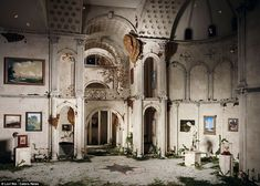 In need of restoration: Statues, paintings and other miniscule artefacts share the decaying space with moss, fungi and ivy, giving this model an ancient feel