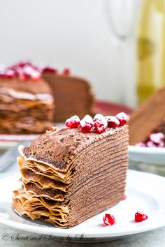 This crepe cake recipe is a keeper! This beautiful chocolate mousse crepe cake is made of layers of delicate chocolate crepes filled with rich chocolate mousse filling and topped with festive red pomegranates. Chocolate Crepes, Chocolate Chocolate, Chocolate Pudding, Dessert Crepes, Best Cake Recipes, Pancake Recipes, Waffle Recipes, Breakfast Recipes, Yummy Recipes