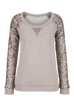 <ul><b>Overview</b><li>adorable baseball style</li><li>sequins sleeves sparkle</li><li>scoop neckline</li><li>dress up or down</li></ul><ul><b>Fabric and Care</b><li>Style Number: 30063</li><li>Imported</li><li>70% rayon 30% polyester; contrast 100% polyester</li><li>Machine wash</li></ul>