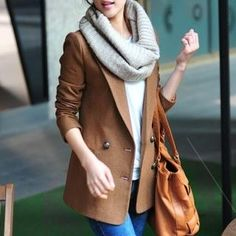 Korean fashion. I am loving the long blazers, big bags and infinity scarves (soft)