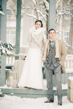 On a mild day, top your wedding gown with a chic sweater, scarf, and gloves that coordinate with your groom's peacoat and scarf.