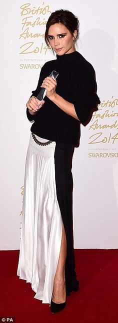 Victoria Beckham in a gorgeous monochrome pleated maxi skirt and backless jumper with curb chain detailing by her design #Brandoftheyear...x