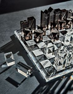 Checkmate. Clear and smoke grey acrylic level up this classic board game that dates from before the 7th century to modern times. Clear board with matte white grid sets the stage for healthy competition while rectangular smoke grey and clear kings, queens, rooks, bishops, knights and pawns battle it out for victory. -Clear and smoke grey acrylic -Dust with a soft, dry cloth -Made in Taiwan Modern Chess Set, Chess Set Unique, Diy Chess Set, Glass Chess Set, Luxury Chess Sets, Classic Board Games, Chess Pieces, Resin Art, Home Gifts