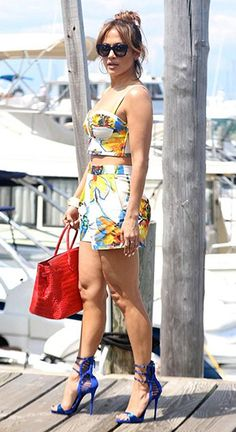 Jennifer Lopez at Sag Harbor on July 25, 2015 in New York, wearing a Milly Pop Art Floral Crop Bustier, Thierry Lasry sunglasses, a Hermes cuff, Milly shorts, a Hermes bag and Giuseppe Zanotti shoes. #jenniferlopez #style