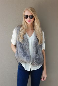 """Every girl needs a fur vest in her Fall wardrobe! Shop the """"Castleton Fur Vest"""" in store and online at Lauren Nicole."""