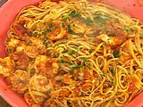 Emeril's shrimp and linguine fra diavolo. I've made this with whole wheat linguine, and it tastes great. Add more red pepper flakes if you like it hottt (less if nottt).