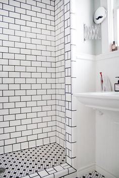 Love the floor and shower tile. And in a different photo, the door is done in chalkboard paint. So fantastic.