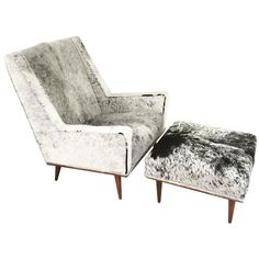Milo Baughman Style Chair and Ottoman in Brazilian Cowhide | From a unique collection of antique and modern chairs at https://www.1stdibs.com/furniture/seating/chairs/