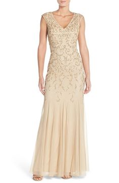 Free shipping and returns on Aidan MattoxEmbellished Mesh Gown at Nordstrom.com. A beautiful silhouette is the hallmark of a flattering gown. This one, in lightweight mesh overlaying a fitted sheath, is shaped with cap sleeves and an alluring V-neckline. Dense beading on the bodice gives way to a delicate tracery from the waist down, emphasizing the flared mermaid silhouette.