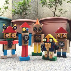 Robot made of old toys, jenga blocks, bottle cap, domino, dice. Repurposing old wooden toy blocks