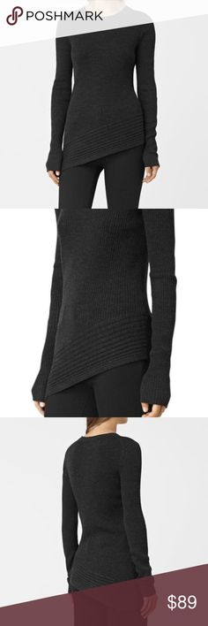 All Saints merino wool crew Crafted from the finest merino wool, this crew neck jumper features multi-directional robbing and asymmetric hem. 100% merino wool. New with tags All Saints Sweaters Crew & Scoop Necks