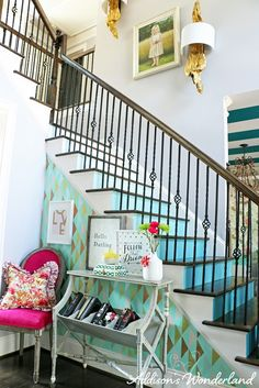 Create an inviting entryway with a bold accent wall and colorful pieces from HomeGoods.  Layering artwork creates interest while bright accessories add a dose of fun to any foyer or nook.  Sponsored by HomeGoods.