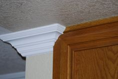 Crown molding returning into a Pre-existing cabinet.   For more examples of our work, please visit our website! www.tflarkin.com Crown Molding Installation, Plank Walls, Home Improvement, Rustic, Cabinet, Diy Ideas, House, Advice, Key