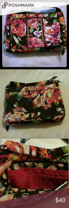 Vera Bradley shoulder bag Vera Bradley shoulder bag on the front has two large compartments and four credit card compartments the back has one large compartment the inside has large compartment and 1 zipper compartment  new without tags from a smoke-free home it looks black but it's dark brown Vera Bradley Bags