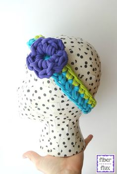 This cute crochet headband by Fiber Flux is perfect for summer fun at the beach or the pool! Make it with Lion Brand Fettuccini!  Get the yarn here: http://lby.co/1o58apg