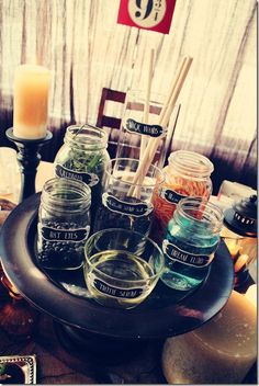 Fill jars of various sizes with interesting items or liquids to create a look like potion ingredients. Add labels to the jars, such as, gillyweed, bat eyes, truth serum, or bloodworms. To make it more fun, try making the items edible.