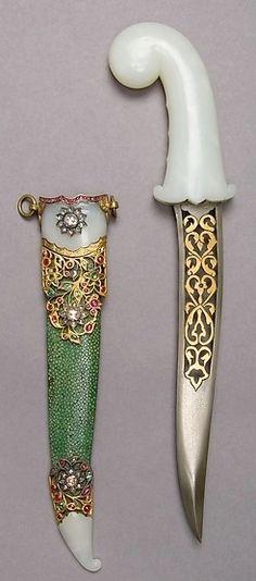 Indian khanjar dagger, 19th century, steel, nephrite, gold, emeralds, rubies, diamonds, ray skin, H. with sheath 15 11/16 in. (39.8 cm); H. without sheath 14 5/8 in. (37.1 cm); W. 3 3/8 in. (8.6 cm); Wt. 15.8 oz. (447.9 g); Wt. of sheath 1.8 oz. (51 g), Met Museum.