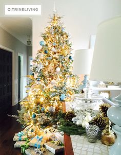 Elegant Christmas tree decor using a rich color palette with tones of turquoise, green, silver and gold | CHRISTMAS HOME TOUR | CITRINELIVING
