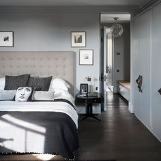 Tonal grey bedroom with dark wood floor | Decorating