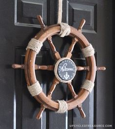"""Upcycle a Ship Helm into a Nautical Wreath"" - right. because everyone just has a spare ship helm laying around. Nautical Wreath, Nautical Rope, Nautical Theme, Nautical Craft, Sailboat Craft, Vintage Nautical, Coastal Homes, Coastal Decor, Coastal Entryway"