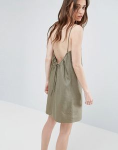 Buy it now. ASOS Linen Sundress with Scoop Back and Tie Detail - Green. Dress by ASOS Collection, Linen-mix fabric, High neck, Low ruched back, Regular fit - true to size, Machine wash, 54% Linen, 46% Viscose, Our model wears a UK 8/EU 36/US 4 and is 173cm/5'8 tall. ABOUT ASOS COLLECTION Score a wardrobe win no matter the dress code with our ASOS Collection own-label collection. From polished prom to the after party, our London-based design team scour the globe to nail your new-season…