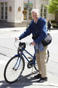 Bill Cunningham. Fashion photographer for the New York Times. There's a documentary about him, you should check it out!