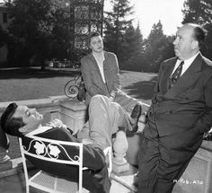 Cary Grant, Ingrid Bergman & Alfred Hitchcock take a break during the filming of Notorious (1946)