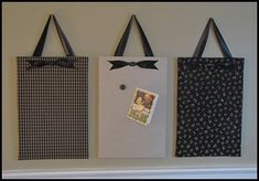 magnet boards. I like the ribbon hanger. Will do this for B's room in her colors