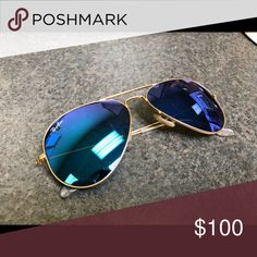 99440dac056 Ray-Ban Aviator Sunglasses Ray-Ban Aviator Sunglasses with blue lenses and  gold frames