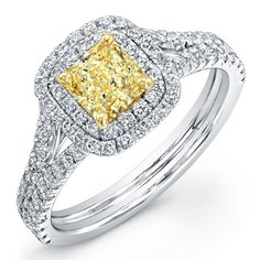 Fancy Yellow Radiant cut diamond set in 18k white gold triple shank with double halo pave ring. (Available from .75 to 3 carats and with Forevermark diamonds)