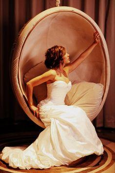 Fun pose, wedding dress  from Circle Park Bridal Boutique.