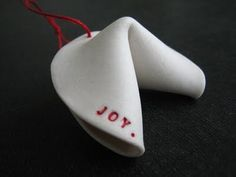 Handmade porcelain fortune cookie ornaments by San Francisco potter, rae dunn
