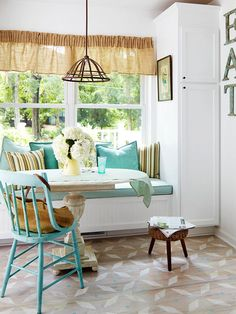 Built-In Seating & pops of turquoise in the kitchen. BHG.
