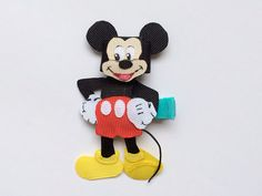 Your favorite mouse for your favorite little girl! This happy fellow is made of grosgrain ribbon and features intricate cuts and a hand painted