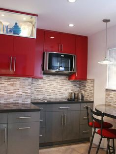 Cool! I think the backsplash looks too busy with everything else, though; maybe stainless steel tiles would have been nice.