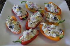 Fiesta Chicken Stuffed Bell Peppers via thehappyhousewife.com - will sub greek yogurt for sour cream and reduced fat mexican cheese or laughing cow for the block of cream cheese.