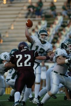 #12 Andrew Luck of Stratford throws a pass as Cy-Fair's #22 Peter Hand closes in fast at the Stratford VS Cy-Fair High School football game at Berry Center