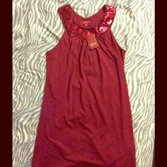 GUESS JUBILEE DRESS Red wine colored, size medium, the length is just above the knee on me so the length may vary on others taller or shorter than 5'9'. Very cute never worn , made in China of 87% polyester and 13% spandex. Guess Dresses Midi