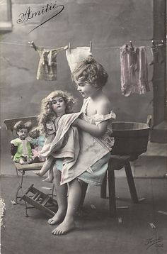 Washing her doll