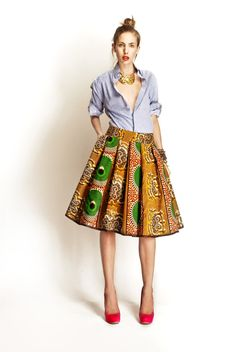 Full African print skirt worn with masculine striped shirt adds a contemporary twist to this look by Stella Jean. Stella Jean, Passion For Fashion, Love Fashion, High Fashion, Womens Fashion, African Print Skirt, African Dress, African Prints, Looks Style