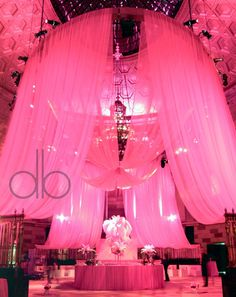 Drapery with dramatic pink lighting.