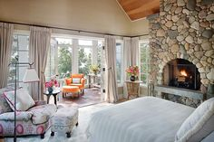 not crazy about the color combinations and I would do the stone fireplace with a different rock, but I love the layout and would love to have the sunroom off of my master.