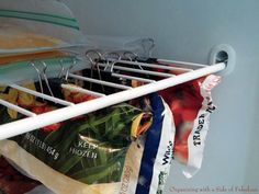 15 Ridiculously Smart Organization Hacks  Make more room in the freezer by clipping opened bags under the shelf